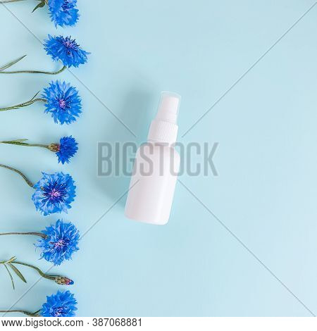 Top View And Close-up Of Mock-up  Of Unbranded White Plastic Spray Bottle And Floral Border Of Blue