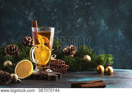 Christmas Or New Year Hot Winter Drink, Spicy Grog Cocktail, Punch Or Mulled Wine With Tea, Lemon, R