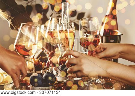 Hands Holding Glasses With Rose Wine Over The Table Served For Festive Dinner Party With Different K