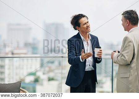 Angry Emotional Businessman Trying To Prove His Point To Colleague In Conversation
