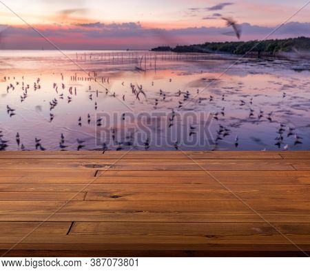 Beautiful Plank Wooden Table, Perspective View, Empty Space For Product Presentation. Blurred Backgr