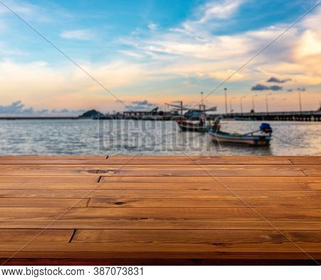 Beautiful Plank Wooden Table, Desk Or Floor. Blurred Background Of Sunset At Sea And Local Fishing B