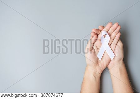 November Lung Cancer Awareness Month, Democracy And International Peace Day. Man Holding White Ribbo