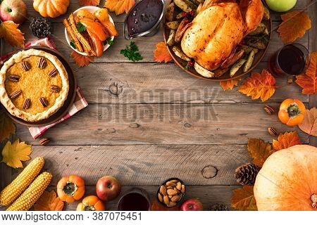 Thanksgiving Dinner With Chicken, Cranberry Sauce, Pumpkin Pie, Wine, Seasonal Vegetables And Fruits