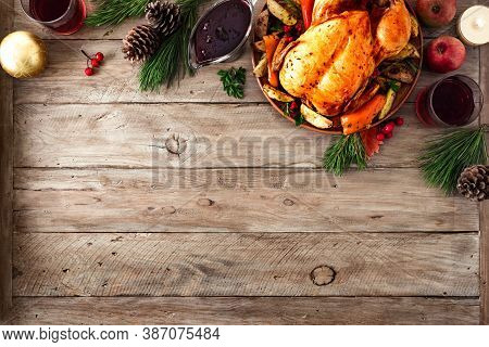 Roasted Christmas Chicken Or Turkey For Christmas Dinner. Festive Decorated Wooden Table For Christm