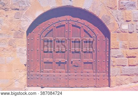 Closed Massive Wooden Door In Italy As A Symbol Of Restricting Tourism In Faded Color Effect.
