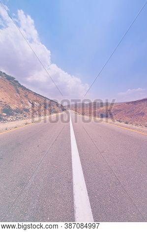 Deserted Road In Israel In Faded Color Effect. Asphalt Highway Through The Middle East Landscape.