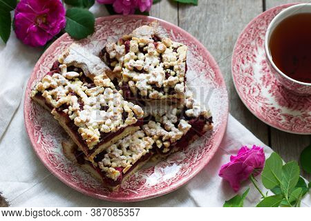 Sweet Cake With Cherry Rose Arenas And Streusel On A Wooden Background. Rustic Style.