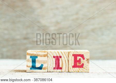 Alphabet Letter In Word Lie On Wood Background