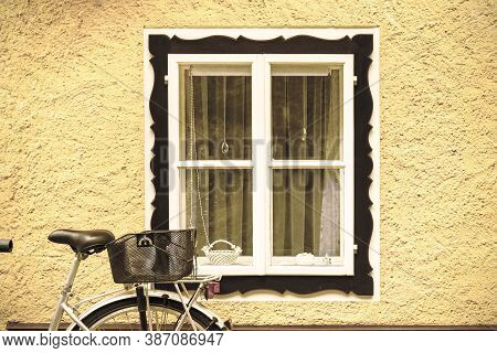 Bike At Home In The Austrian City Of Hallstatt On A Rainy Day. Typical Window Of A House In A Small