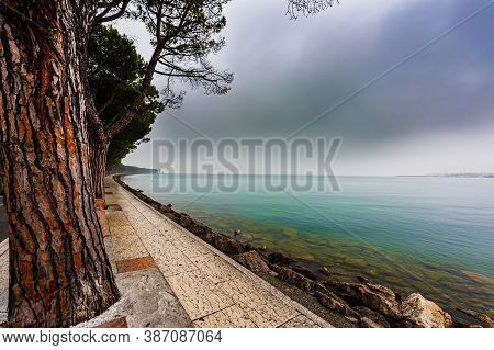 Deserted Shore Of Lake Garda In Italy In The Absence Of Tourism