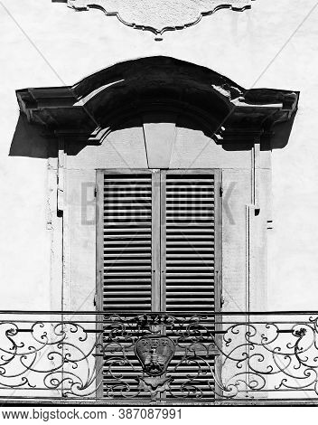 Closed Shutters In The Italian City Of Arezzo As A Symbol Of Restricting Tourism In Black And White