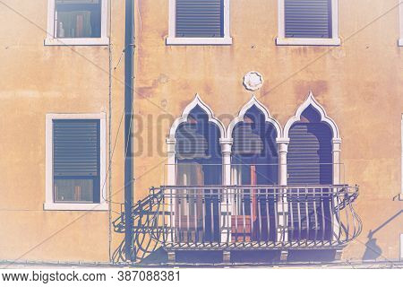 Italian Culture On Venetian Facades In Faded Color Effect. Venice Is Rich And Poor, Well-groomed And