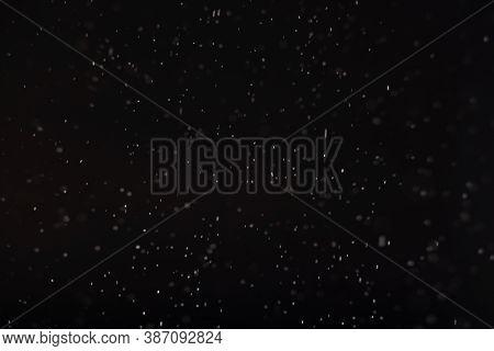 Dark Winter Background. Blur White Snowflakes Falling Isolated On Black. Christmas Night Sky Blizzar