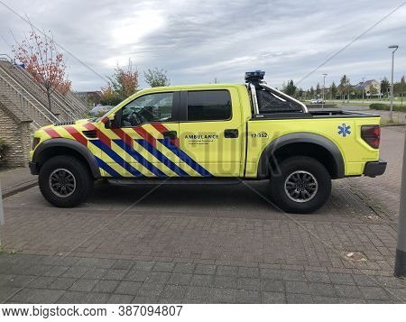 Almere, The Netherland - September 27, 2020: Ford Raptor F150 In Dutch Ambulance Striping Parked On