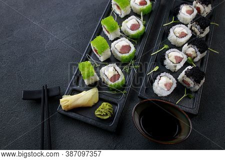 Seafood Delicatessen Sushi Rolls Set On Plates. Different Gourmet Snacks. Japanese Restaurant Menu,