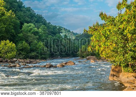 The Ocoee River In Tennessee With Its Whitewater Flowing Downstream Closeup With The Mist In The Mou