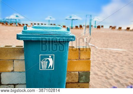 Trash Can On The Beach. Plastic Large Waste Tank. Maintaining Cleanliness In The Recreation Area Of