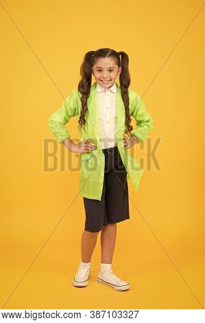 Rainy Day. Cute Schoolgirl Feel Protected For Spring Weather. Waterproof Concept. Kids Raincoats Wit