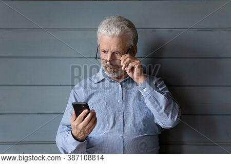Shocked Mature Man Surprised By Unexpected Cell Message