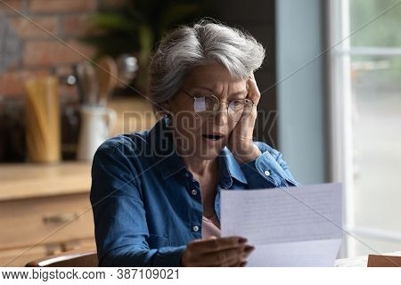Unhappy Senior Woman Shocked By Bad News In Postal Correspondence