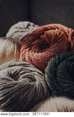 Close Up Of Earth Coloured Coloured Skeins Of Wool Yarn, Selective Focus.