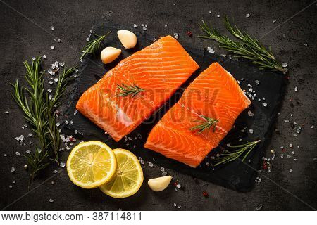 Salmon, Fresh Salmon Fillet At Cutting Board With Ingredients For Cooking. Top View With Copy Space.