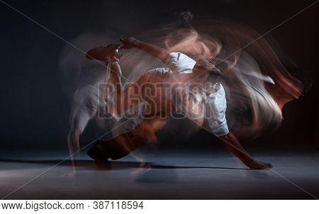 Guy Breakdancer Dancing Hip-hop On The Floor In Studio On Black Background. Dance School Poster. Lon
