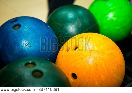 Bowling. Multicolored Bowling Balls On The Shelf In The Bowling Club.