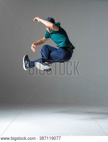 Cool Man Breakdancer Jumps Dancing Hip-hop Isolated On Gray Background. Dance School Poster. Break D