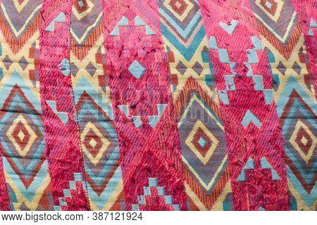 close up of boho style colorful pouf pattern