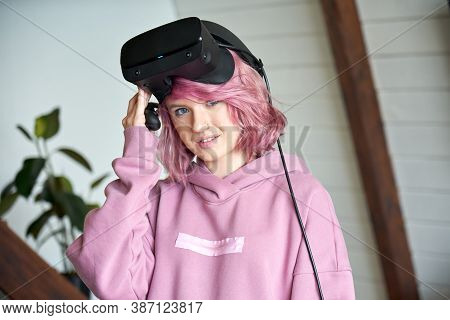 Hipster Fashion Woman With Pink Hair Wears Vr Glasses Headset Holds Controller Looks At Camera. Digi