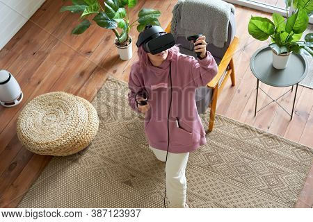Young Woman Pink Hair Wears Vr Headset Goggles Holds Controllers Plays Vr Video Game Futuristic Imme