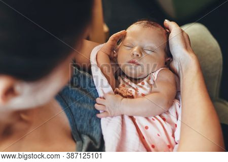 Upper View Photo Of A Caucasian Mother Embracing Her Newborn Baby Sleeping In Safety