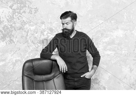 Discover Latest Trends In Mens Style. Bearded Man Stand At Office Chair. Brutal Hipster Wear Casual