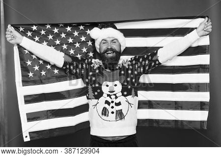 Merry American Xmas. Happy Santa Hold American Flag. Bearded Man Celebrate Xmas. Holiday Decoration