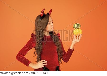 Autumn Holidays. Pumpkins Traditional Attribute Of Fall Holidays. Happy Holidays. Cute Child Celebra