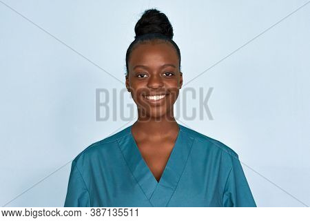 Happy Young Female African American Scrub Nurse Wear Blue Uniform Standing Isolated On Background. B