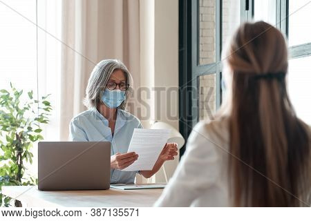 Old Hr Manager Checking Female Job Applicant Cv Resume At Job Interview Meeting. Senior Employer Wea