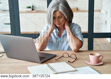 Tired Stressed Old Mature Business Woman Suffering From Neckpain Working From Home Office Sitting At