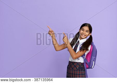 Happy Indian Kid Primary Elementary School Girl With Backpack Wearing School Uniform Pointing Finger