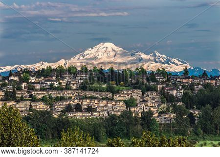Sunset Over Mount Baker, A Dormant Volcano In Washington State. View From Coquitlam City Over The Vi