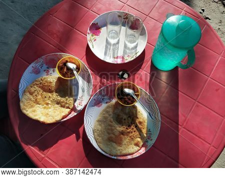 Indian Aloo Paratha Served On A Highway Restaurant. It's Unleavened Dough Rolled With A Mixture Of M