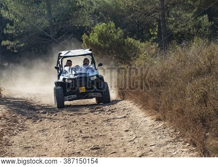 Mevasseret Zion, Israel - September 27th, 2020: Two Men In An All Terrain Vehicle On A Forest Path I