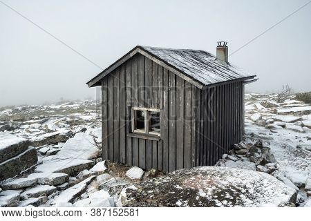Small, old traditional house in Scandinavia. Wooden shelter hut in remote region of Finland.