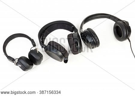 High-fidelity Headset And Headphones With Earpads Of Different Types On A White Background