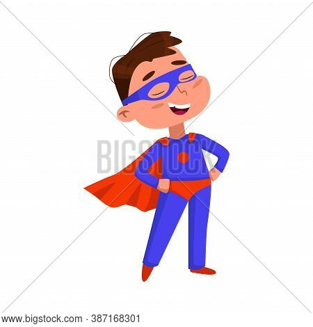 Cute Boy In Blue Superhero Costume And Red Cape, Adorable Kid Character Standing In Superhero Pose W