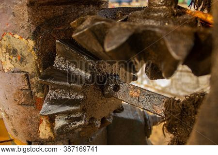 Close Up Of Oily And Greasy Mechanical Gears In A Machine