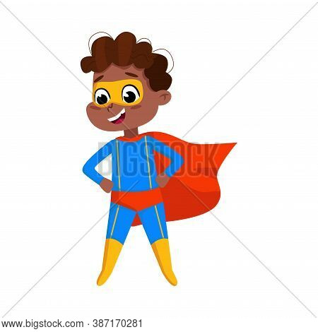 Cute African American Boy In Blue Superhero Costume And Red Cape, Adorable Kid Superhero Standing Wi