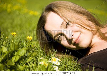Woman Resting In Meadow